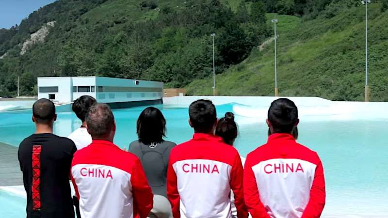 The Chinese Olympic surfing team studies the cove